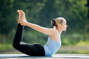 Woman in bow pose